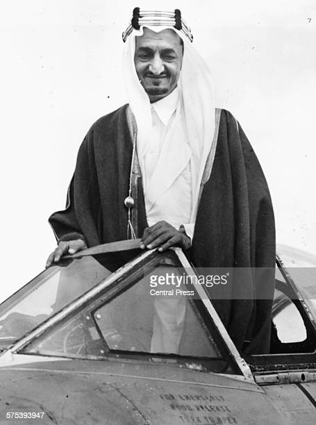 Prince Faisal of Saudi Arabia pictured standing up in the cockpit of a Meteor jet fighter during a visit to RAF Biggin Hill England August 13th 1951