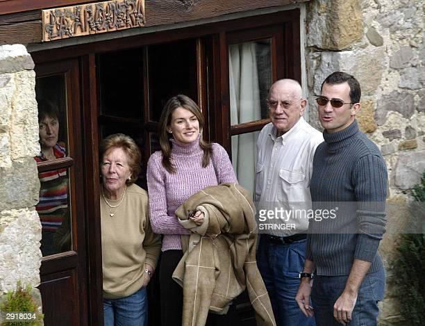 Prince Felipe and his fiancee Letizia Ortiz pose with Letizia's grandparents Menchu Alvares and JoseLuis Ortiz at their home in Sardeu in northern...