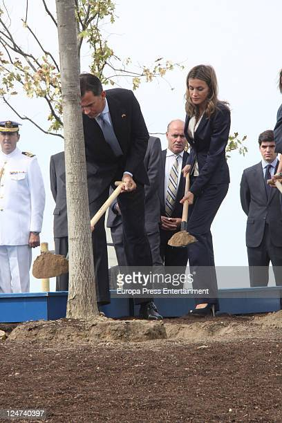 Prince Felipe and Princess Letizia help to plant an oak tree to honour 9/11 victims at Juan Carlos I Park on September 11 2011 in Madrid Spain
