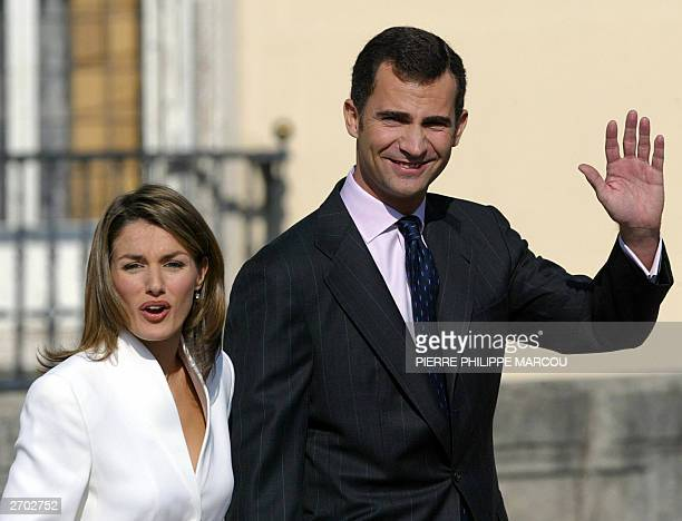 Prince Felipe of Spain and his fiancee Spanish journalist Letizia Ortiz Rocasolano wave at the Pardo Palace near Madrid 06 November 2003 Prince...