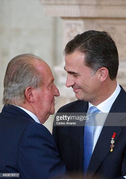 Prince Felipe of Spain and King Juan Carlos of Spain attend the official abdication ceremony at the Royal Palace on June 18 2014 in Madrid Spain