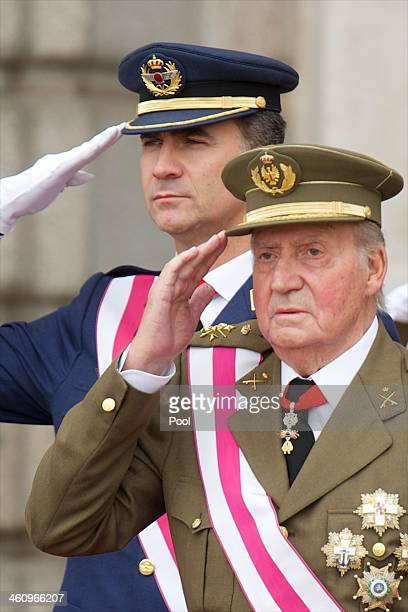 Prince Felipe of Spain and King Juan Carlos of Spain attend the New Year's Military Parade at the Royal Palace on January 6 2014 in Madrid Spain