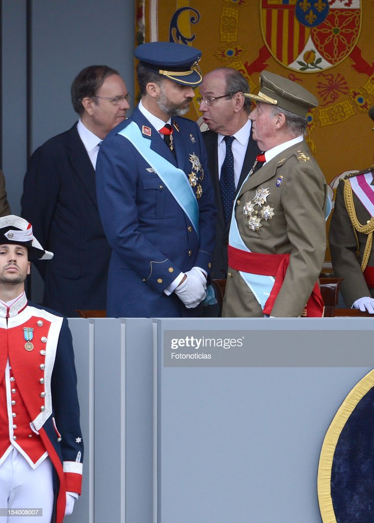 Prince Felipe of Spain and King Juan Carlos of Spain,attend the National Day Military Parade on October 12, 2012 in Madrid, Spain.