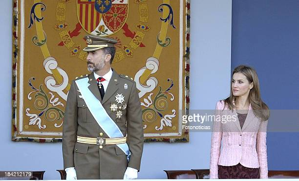 Prince Felipe of Spain and Princess Letizia of Spain attend the National Day Military Parade at Plaza de Neptuno on October 12 2013 in Madrid Spain