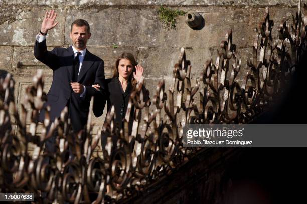 Prince Felipe of Spain and Princess Letizia of Spain leave the Santiago de Compostela Cathedral folowing the memorial Mass for the victims of the...
