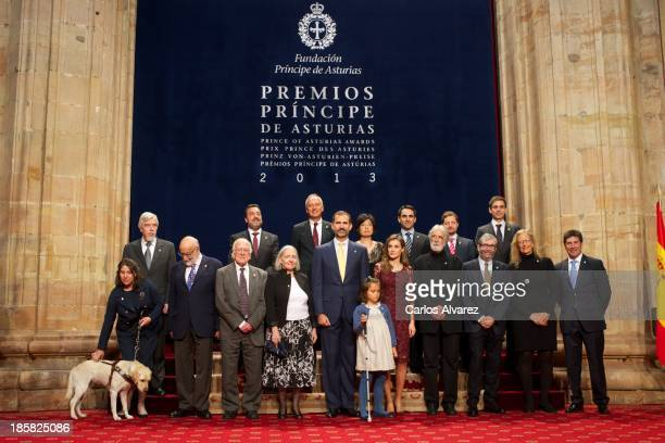 Prince Felipe of Spain and Princess Letizia of Spain pose for a picture with the 2013 Prince of Asturias Award laureates at the Reconquista Hotel on...