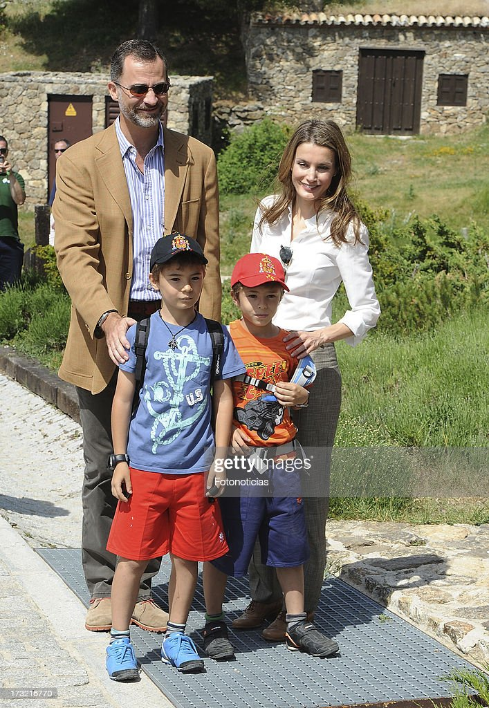 Prince Felipe of Spain (L) and Princess Letizia of Spain (R) pose with two children visitors during their visit to Sierra de Guadarrama National Park on July 10, 2013 in Rascafria, Spain.