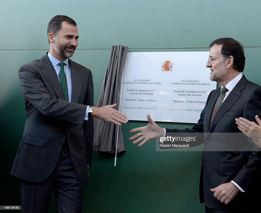 Prince Felipe of Spain and Spanish Prime Minister Mariano Rajoy unveil a commemorative plaque at the Figueres-Vilafant train station for the inauguration of the AVE high-speed train line between Barcelona and the French border on January 8, 2013 in Barcelona, Spain.