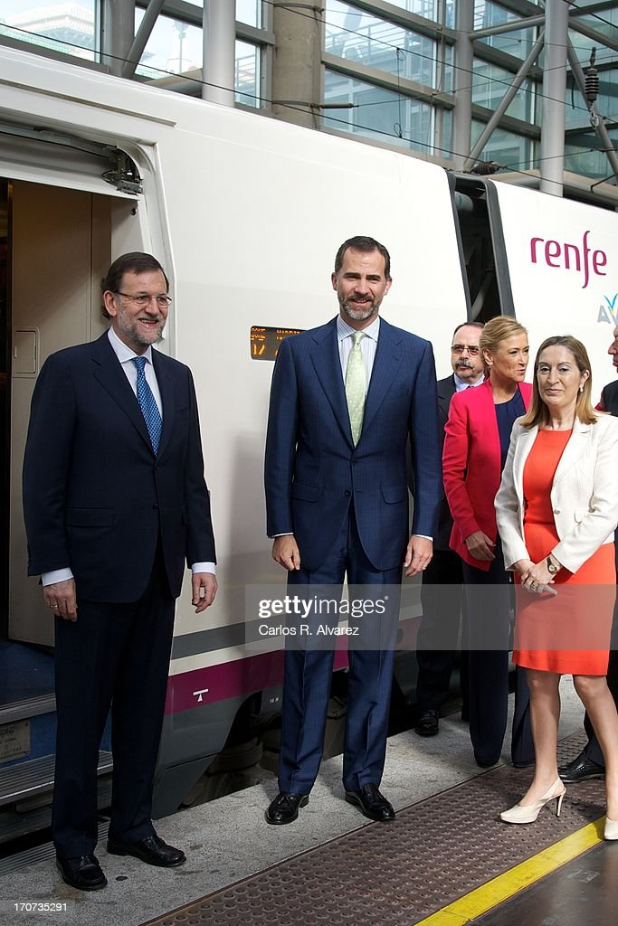 Prince Felipe of Spain (C) and Spanish Prime Minister Mariano Rajoy (L) attend the official inauguration of the new Alta Velocidad Espanola (AVE) high speed Madrid to Alicante rail link at Atocha AVE station on June 17, 2013 in Madrid, Spain.