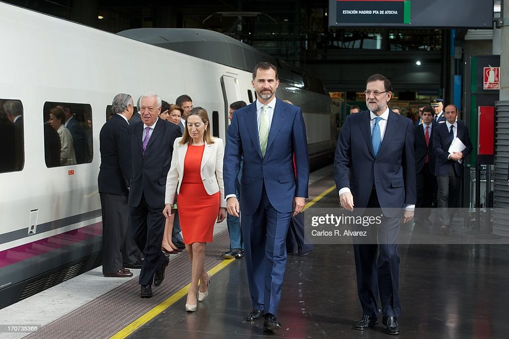 Prince Felipe of Spain (C) and Spanish Prime Minister Mariano Rajoy (R) attend the official inauguration of the new Alta Velocidad Espanola (AVE) high speed Madrid to Alicante rail link at Atocha AVE station on June 17, 2013 in Madrid, Spain.