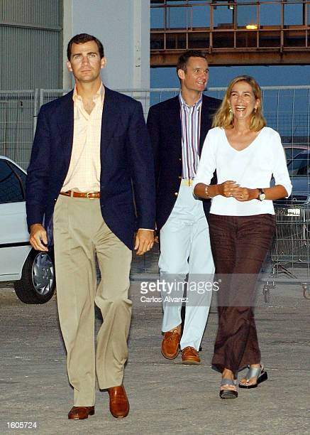 Prince Felipe of Spain left his sister Princess Cristina and her husband Inaki Urdangarin arrive at the Spanish military training ship Juan Sebastian...