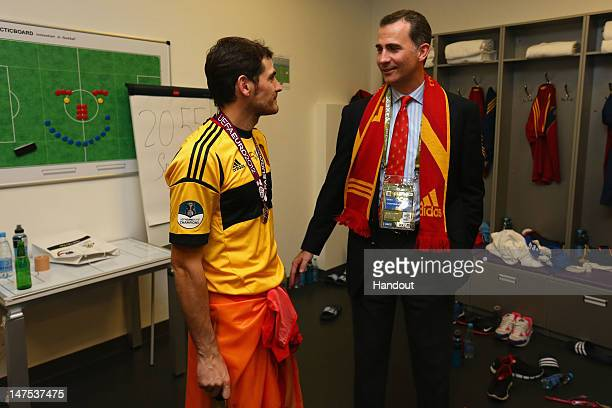 Prince Felipe of Spain speaks to Iker Casillas of Spain in the dressing room following the UEFA EURO 2012 final match between Spain and Italy at the...