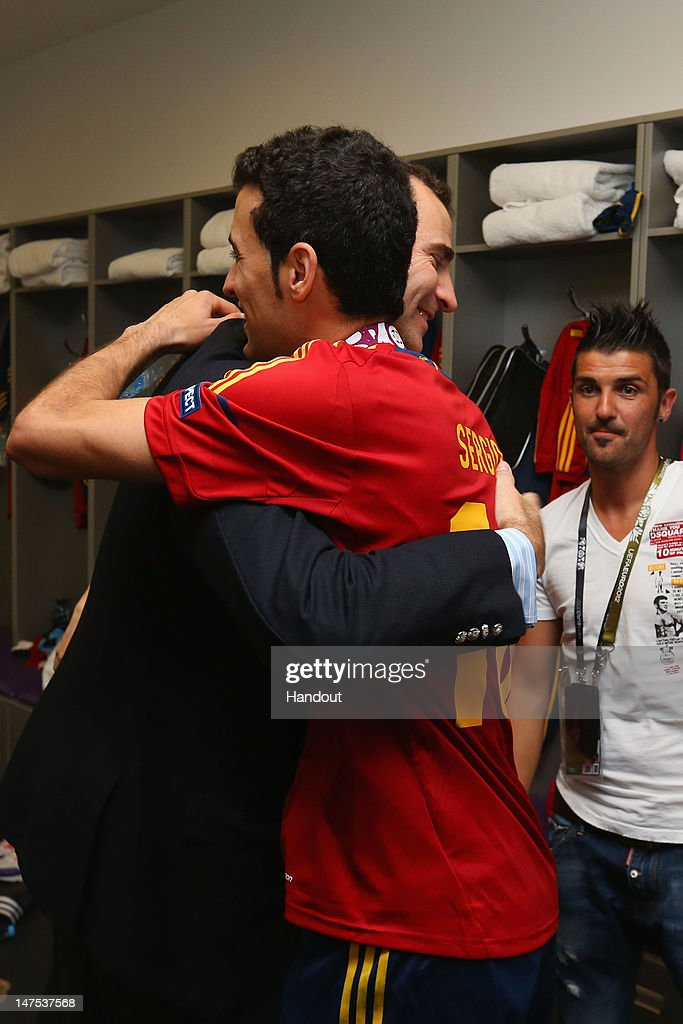 Prince Felipe of Spain speaks with Sergio Busquets of Spain in the dressing room following the UEFA EURO 2012 final match between Spain and Italy at the Olympic Stadium on July 1, 2012 in Kiev, Ukraine.