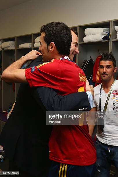 Prince Felipe of Spain speaks with Sergio Busquets of Spain in the dressing room following the UEFA EURO 2012 final match between Spain and Italy at...
