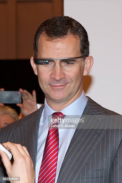 Prince Felipe of Spain wears an google glass during the 'Fitur' International Tourism Fair opening at Ifema on January 22 2014 in Madrid Spain