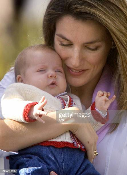 Prince Felipe's wife Letizia poses with their daughter Leonor in Costa Teguise on the Lanzarote Island 27 December 2005 Leonor is second in line to...