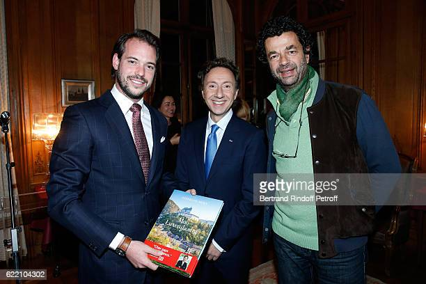 Prince Felix de Luxembourg Stephane Bern and Photographer for the book Guillaume de Laubier attend Stephane Bern signs his Book 'Mon Luxembourg' at...
