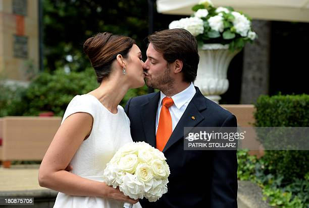 Prince Felix of Luxembourg and German student Claire Lademacher kiss while posing for pictures after their Civil Wedding Ceremony at Villa Rothschild...