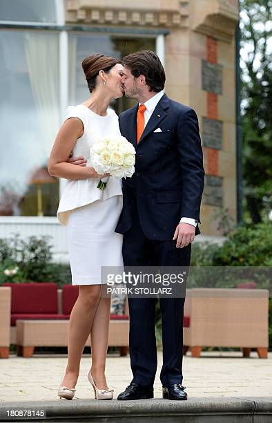Prince Felix of Luxembourg and German student Claire Lademacher kiss under the rain as they pose for pictures after their Civil Wedding Ceremony at...