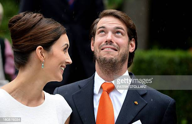 Prince Felix of Luxembourg and German student Claire Lademacher look at the rain as they pose for pictures after their Civil Wedding Ceremony at...