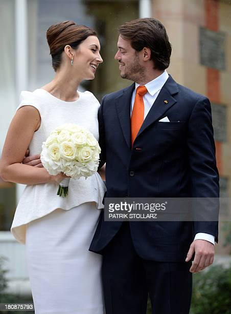 Prince Felix of Luxembourg and German student Claire Lademacher pose for pictures under the rain after their Civil Wedding Ceremony at Villa...
