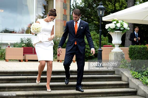 Prince Felix of Luxembourg and German student Claire Lademacher walk under the rain to pose for pictures after their Civil Wedding Ceremony at Villa...