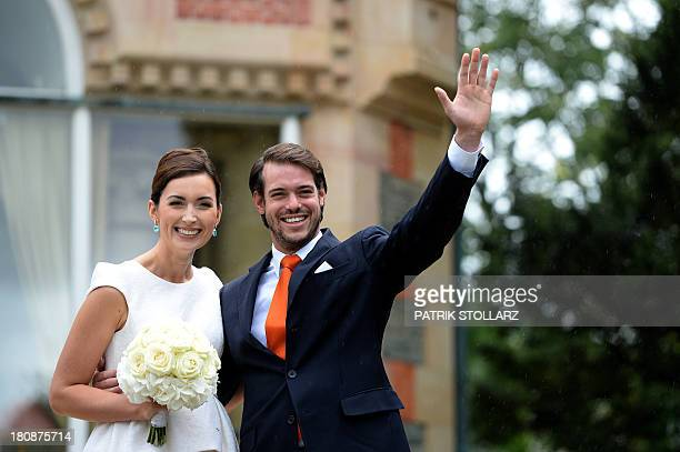 Prince Felix of Luxembourg and German student Claire Lademacher wave while posing for pictures after their Civil Wedding Ceremony at Villa Rothschild...