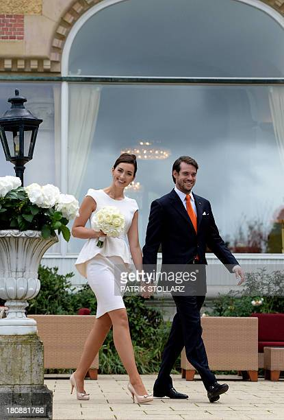 Prince Felix of Luxembourg and his wife German student Claire Lademacher arrive to pose for photographers after their Civil Wedding Ceremony at Villa...