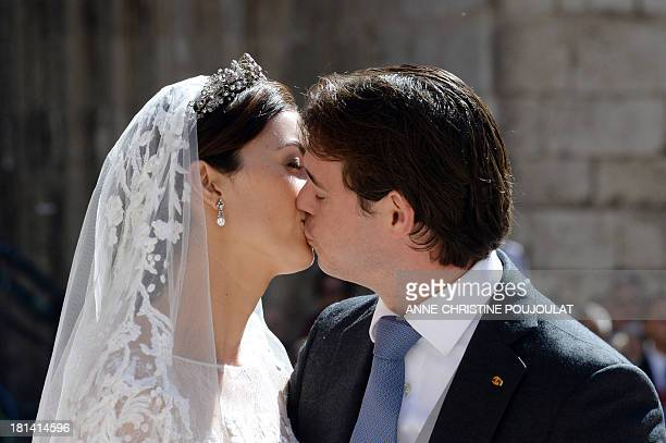 Prince Felix of Luxembourg and his wife German student Claire Lademacher kiss each other after their religious wedding ceremony on September 21, 2013...