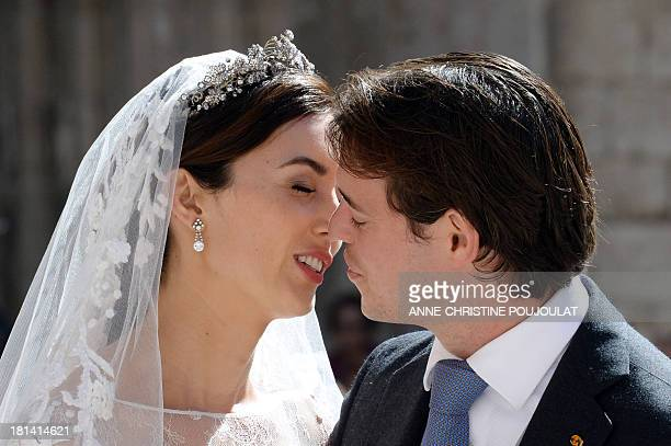 Prince Felix of Luxembourg and his wife German student Claire Lademacher kiss each other after their religious wedding ceremony on September 21 2013...