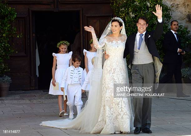 Prince Felix of Luxembourg and his wife German student Claire Lademacher leave the church after their religious wedding ceremony on September 21,...