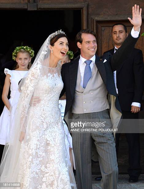 Prince Felix of Luxembourg and his wife German student Claire Lademacher leave their religious wedding ceremony on September 21 2013 at the Saint...