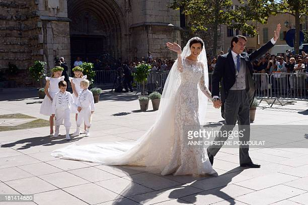 Prince Felix of Luxembourg and his wife German student Claire Lademacher leave the church after their religious wedding ceremony on September 21 2013...