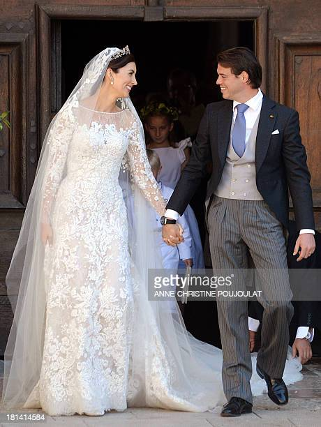 Prince Felix of Luxembourg and his wife German student Claire Lademacher look at each other as they leave the church after their religious wedding...