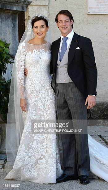 Prince Felix of Luxembourg and his wife German student Claire Lademacher pose for photographers after their religious wedding ceremony on September...