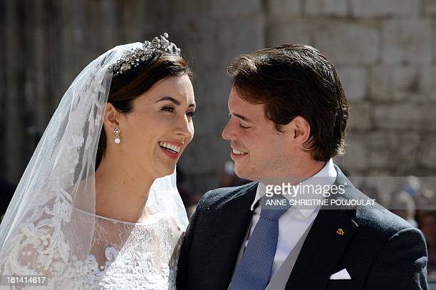 Prince Felix of Luxembourg and his wife German student Claire Lademacher smile after their religious wedding ceremony on September 21 2013 at the...