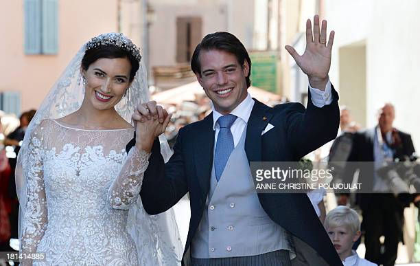 Prince Felix of Luxembourg and his wife German student Claire Lademacher wave after their religious wedding ceremony on September 21, 2013 at the...