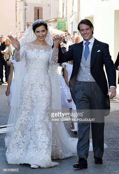 Prince Felix of Luxembourg and his wife German student Claire Lademacher wave after their religious wedding ceremony on September 21 2013 at the...