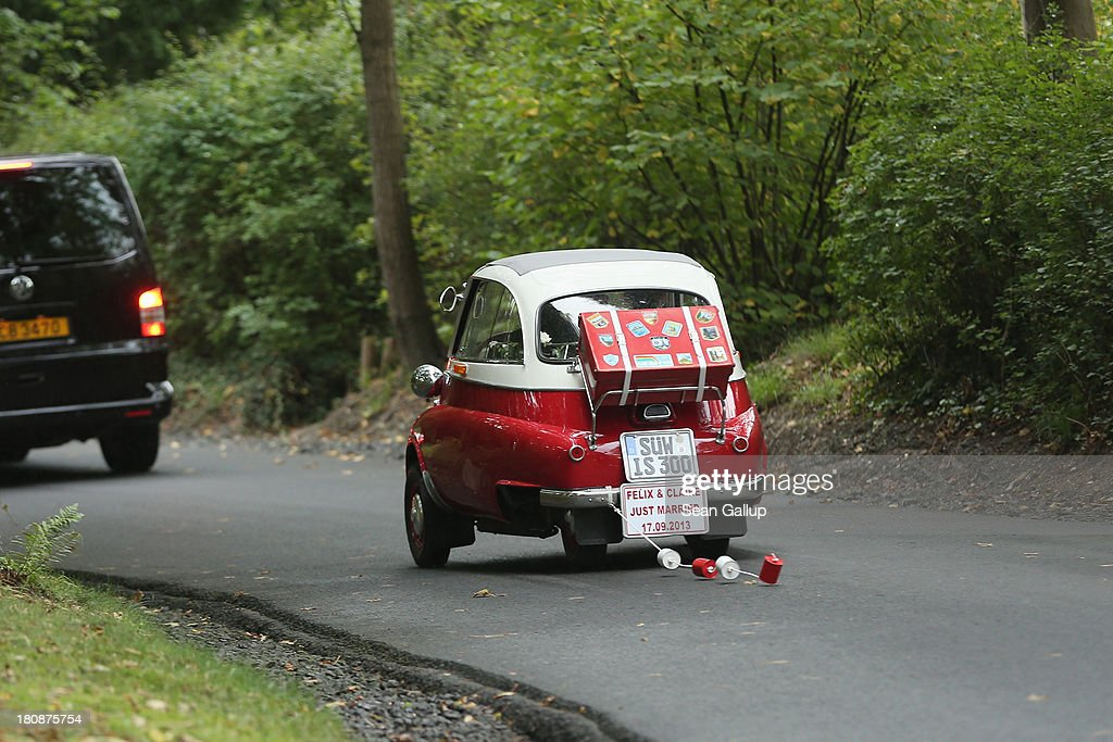Prince Felix Of Luxembourg and Princess Claire of Luxembourg depart in the Italian-designed BMW Isetta 300 microcar after their Civil Wedding Ceremony at Villa Rothschild Kempinski on September 17, 2013 in Konigstein, Germany.