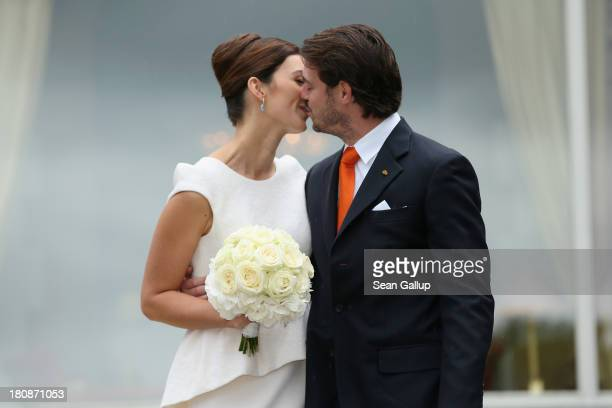 Prince Felix Of Luxembourg and Princess Claire of Luxembourg kiss in front of photograhers after taking their vows at their Civil Wedding Ceremony at...