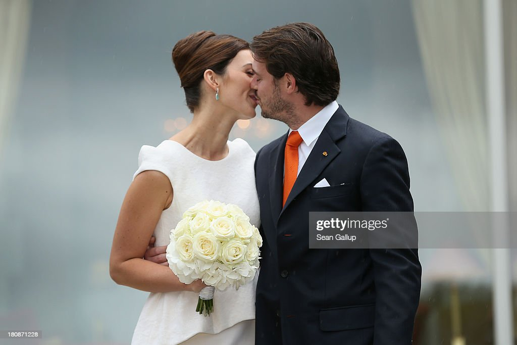 Prince Felix Of Luxembourg and Princess Claire of Luxembourg kiss in front of photograhers after taking their vows at their Civil Wedding Ceremony at Villa Rothschild Kempinski on September 17, 2013 in Konigstein, Germany.