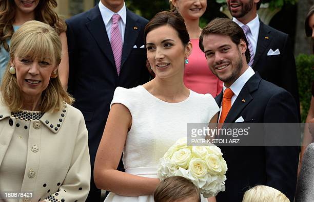 Prince Felix of Luxembourg , his wife German student Claire Lademacher and her mother Gabriele Lademacher-Schneider pose for a family picture after...