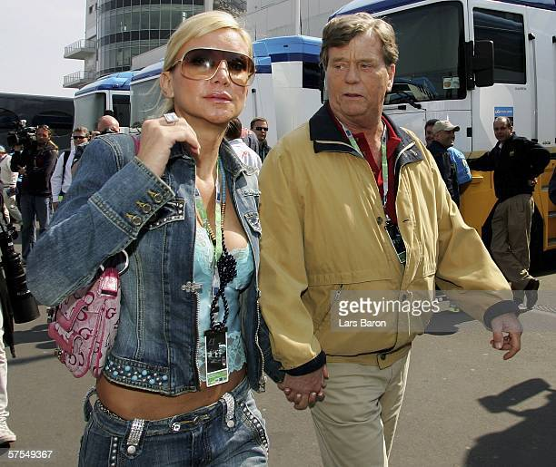 Prince Ferfried von Hohenzollern and Tatjana Gsell walks through the paddock before the F1 Grand prix of Europe at the Nurburgring on May 7 in...