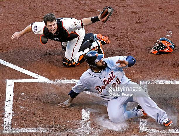 Prince Fielder of the Detroit Tigers reacts after he was tagged out at home plate by catcher Buster Posey of the San Francisco Giants during the...