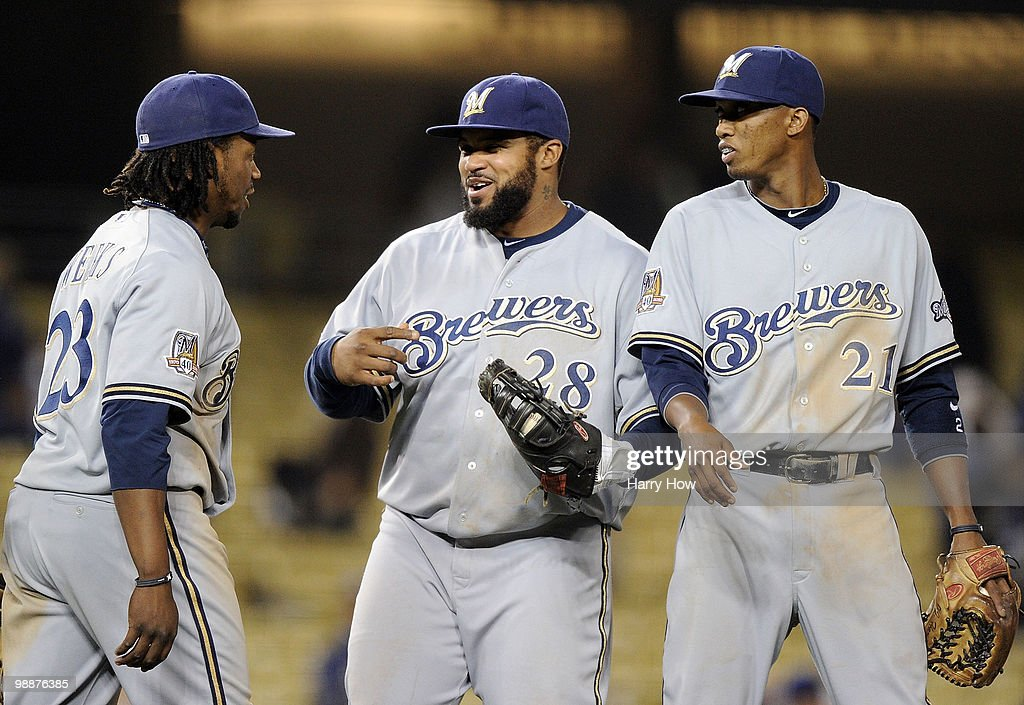 Prince Fielder #28, Alcides Escobar #21 and Rickie Weeks #23 of the Milwaukee Brewers celebrate a 11-3 win over the Los Angeles Dodgers at Dodger Stadium on May 5, 2010 in Los Angeles, California.