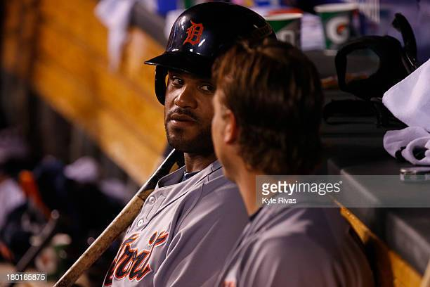 Prince Fielder converses with Andy Dirks of the Detroit Tigers during the ninth inning against the Kansas City Royals on September 7 2013 at Kauffman...