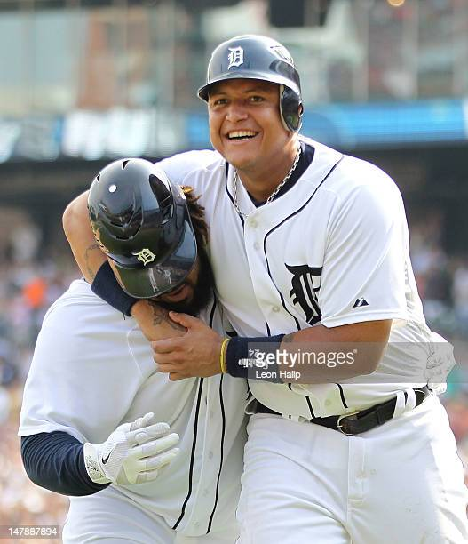 Prince Fielder of the Detroit Tigers is congratulated by teammate Miguel Cabrera after hitting a three-run home run in the eighth inning against the...
