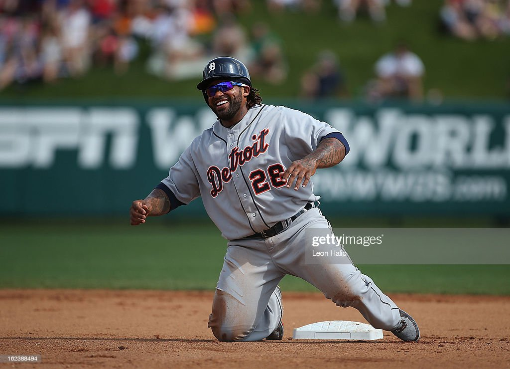 Prince Fielder #28 of the Detroit Tigers shares a laugh after sliding into second base during the game against the Atlanta Braves on February 22, 2013 in Lake Buena Vista, Florida. The Tigers defeated the Braves 2-1.
