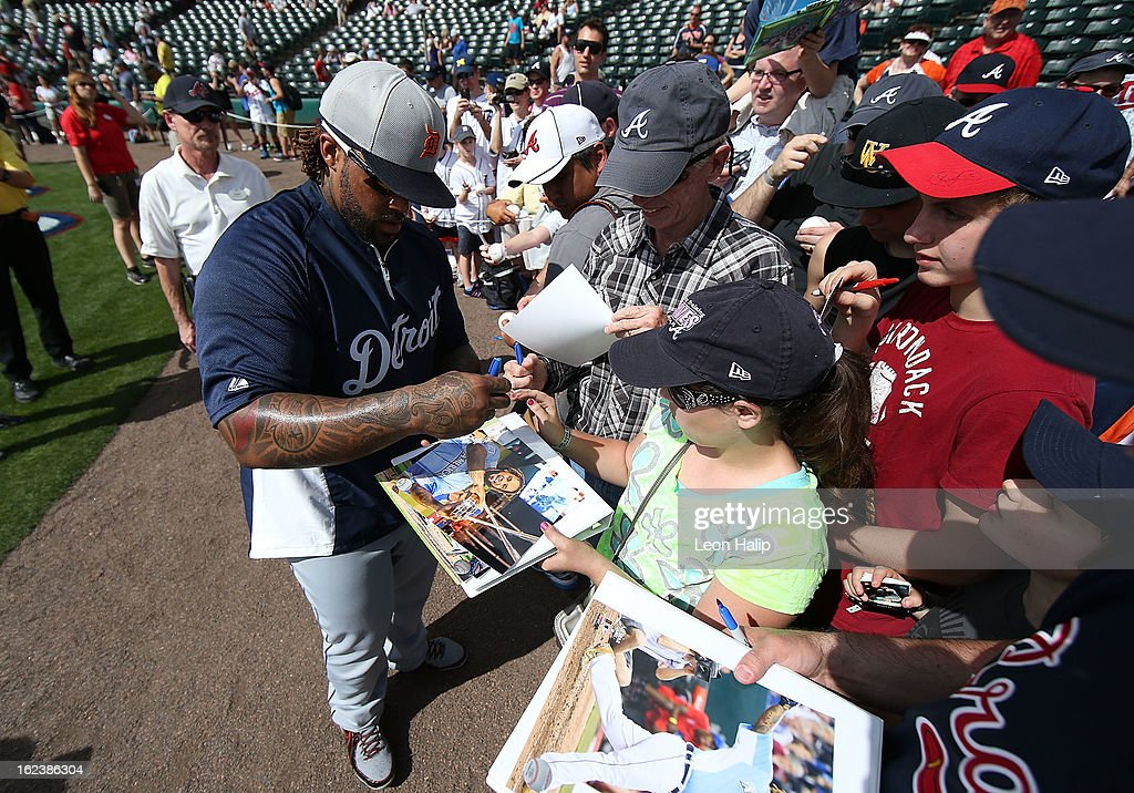 Prince Fielder #28 of the Detroit Tigers signs autographs for the fans prior to the start of thw game against the Atlanta Braves on February 22, 2013 in Lake Buena Vista, Florida. The Tigers defeated the Braves 2-1.