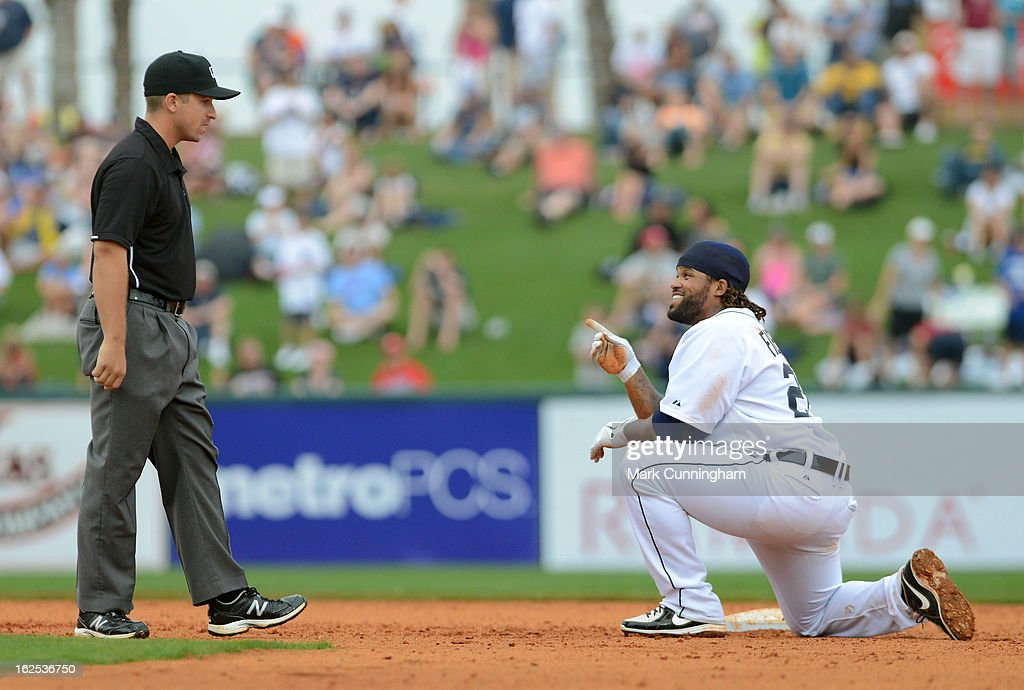 Prince Fielder #28 of the Detroit Tigers talks with umpire Jeff Gosney after being called out on a play at second base during the spring training game against the Philadelphia Phillies at Joker Marchant Stadium on February 24, 2013 in Lakeland, Florida. The game ended in a 10 inning 5-5 tie.